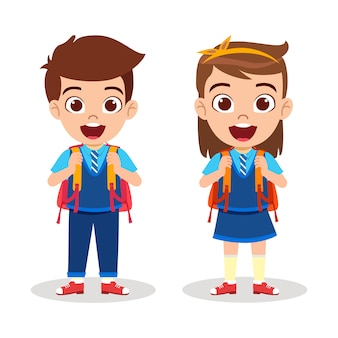 Happy cute beautiful school kid boy and girl standing ready to go school with cheerful expression