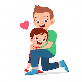 Happy cute boy hugging dad love