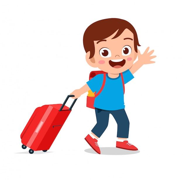 Happy cute boy pull bag go travel
