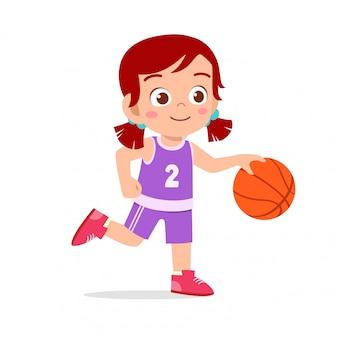 Happy cute girl playing basketball