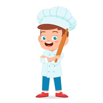 Happy cute kid boy in chef costume