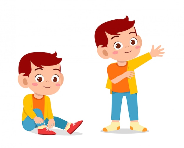 幸せなかわいい子供男の子はドレッシングプロセスを行う