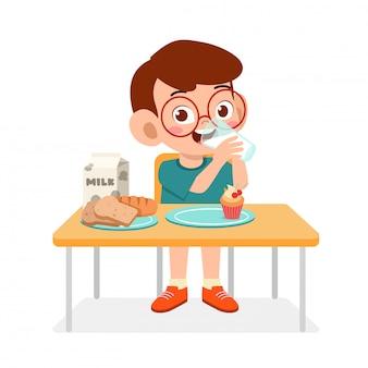 Happy cute kid boy eat healthy food