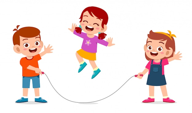 Happy cute kid boy and girl play jump rope
