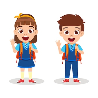 Happy cute kid boy and girl standing ready to go school and waving with cheerful expression