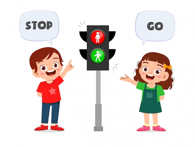 Happy cute kid boy and girl with traffic sign