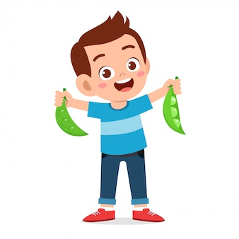 Happy cute kid boy holding fresh vegetable