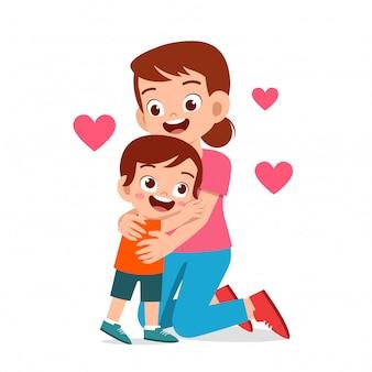 Happy cute kid boy hugging mom love