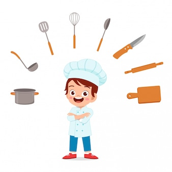 Happy cute kid boy ins chef costume
