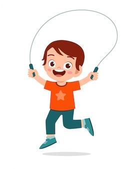 Happy cute kid boy play jump rope