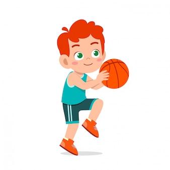 Happy cute kid boy play train basketball
