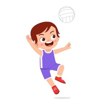 Happy cute kid boy play train volleyball