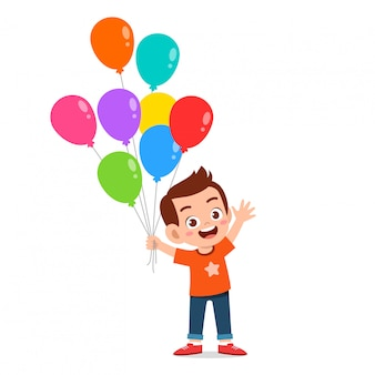 Happy cute kid boy run holding balloon