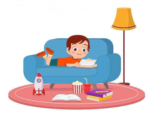 Happy cute kid boy use smartphone on sofa