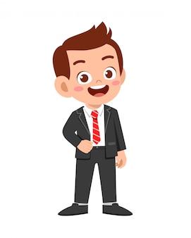 Happy cute kid boy wear suit blazer tuxedo