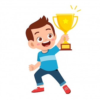 Happy cute kid boy win game gold trophy