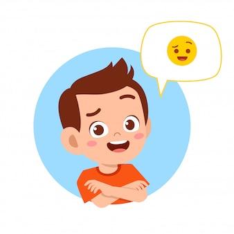 Happy cute kid boy with emoji expression
