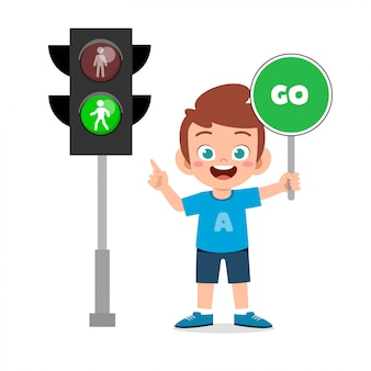 Happy cute kid boy with traffic sign