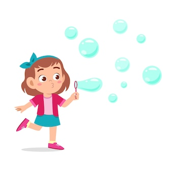 Happy cute kid girl blow bubble soap