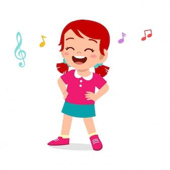 Happy cute kid girl dance with music