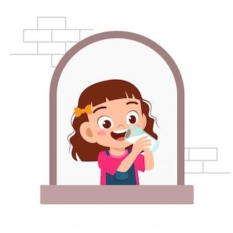 Happy cute kid girl expression on window