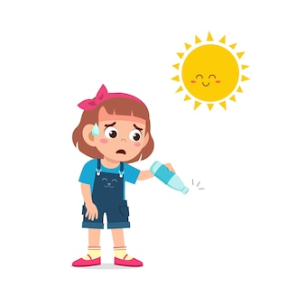 Happy cute kid girl feels so thirsty because of hot weather at summer season
