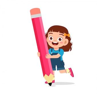 Happy cute kid girl holding big pencil
