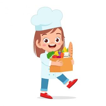 Happy cute kid girl holding fresh groceries