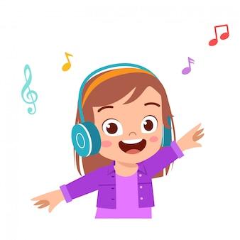 Happy cute kid girl listen good music
