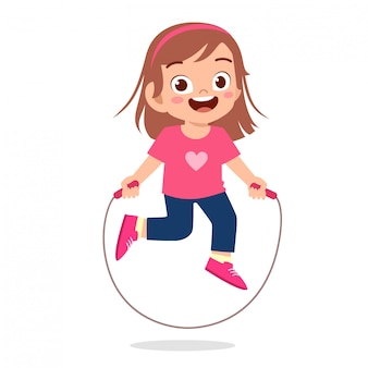 Happy cute kid girl play jump rope