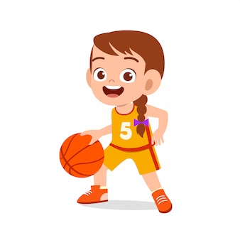 Happy cute kid girl play train basketball