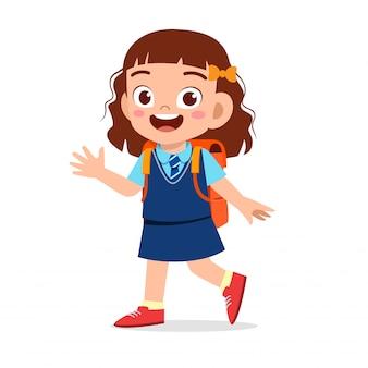 幸せなかわいい子供の女の子が学校に行く準備ができて