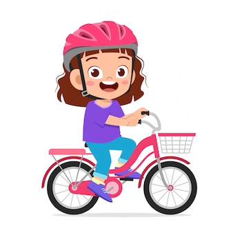 Happy cute kid girl riding bike smile
