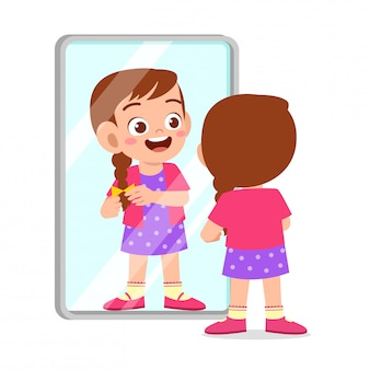 Happy cute kid girl use mirror in morning