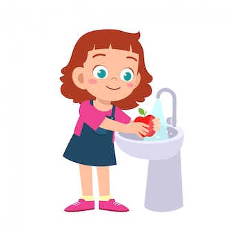 Happy cute kid girl wash vegetable fruit clean