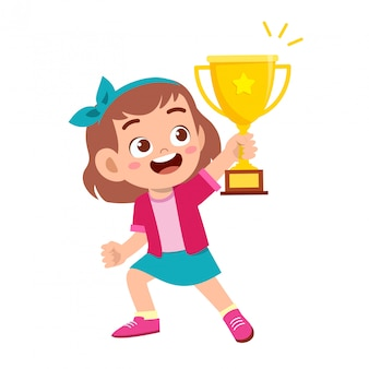Happy cute kid girl win game gold trophy
