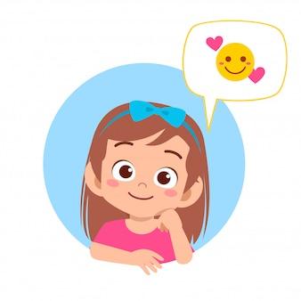 Happy cute kid girl with emoji expression