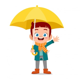 Happy cute kid use umbrella rain day