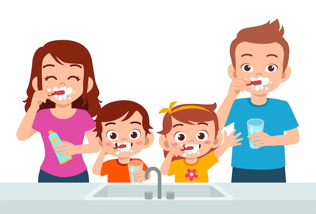 Happy cute kids boy and girl brush teeth with parent