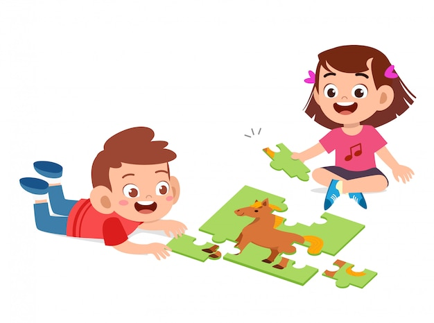 Happy cute kids play solve puzzle together