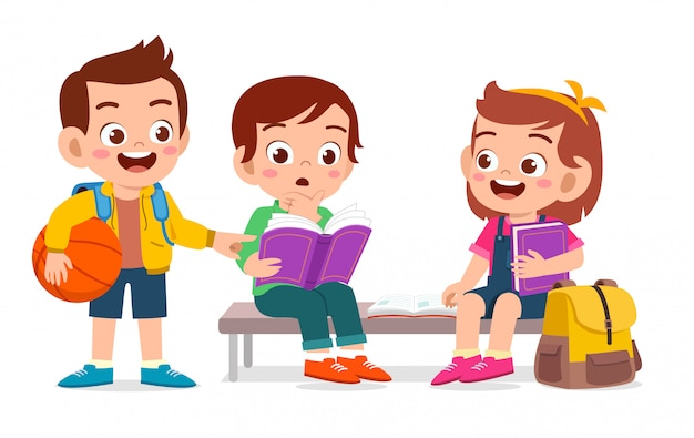Happy cute kids reading book together