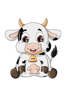 座っている幸せなかわいい牛