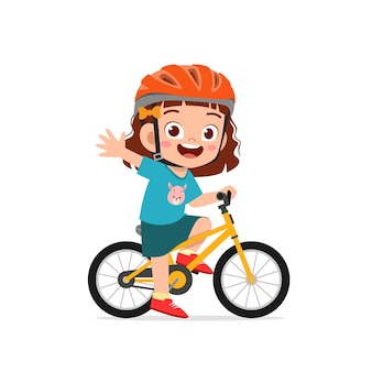 Happy cute little girl boy riding bicycle