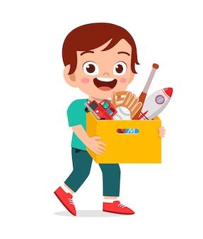 행복 한 귀여운 작은 아이 소년 장난감 상자를 가지고