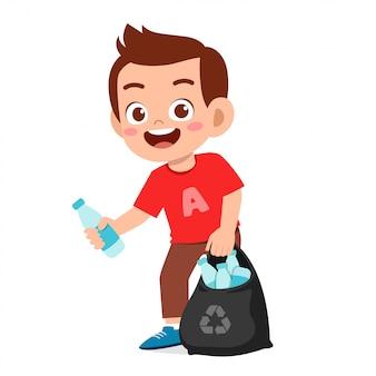 Happy cute little kid boy collect trash