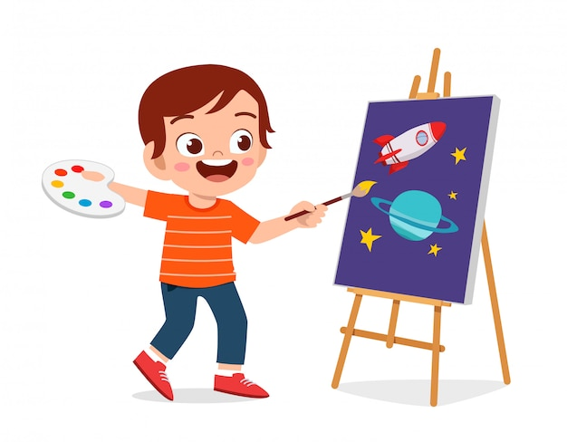 Happy cute little kid boy draw on canvas