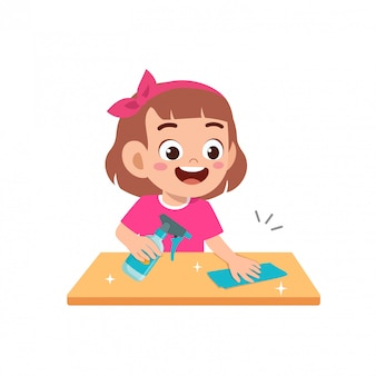 Happy cute little kid boy and girl do chores cleaning table