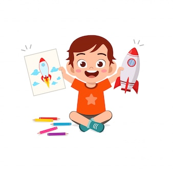 Happy cute little kid boy and girl draw with crayon on paper