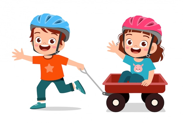 Happy cute little kid boy and girl play toy wagon
