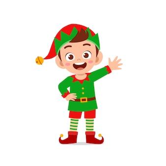 Happy cute little kid boy and girl wearing green elf christmas costume
